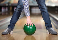 Bowling Game. Cheerful young man playing bowling Royalty Free Stock Photo
