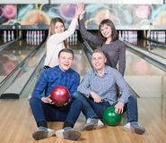 Bowling Game. Funny young people smiling at the camera playing bowling Stock Photos