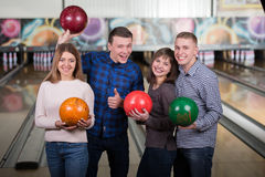 Bowling Game. Funny young people smiling at the camera playing bowling Stock Images