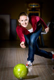 Bowling girl. A young woman playing bowling Royalty Free Stock Images