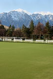 Bowling green with a view. Bowling green with view of snow capped mountains Royalty Free Stock Photos
