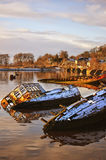 Bowling harbour 02. Sunken fishing boats lined up in the scottish harbour at Bowling Stock Images