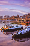 Bowling harbour 03. Sunken fishing boats lined up in the scottish harbour at Bowling Stock Image