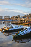 Bowling harbour. Sunken fishing boats lined up in the scottish harbour at Bowling Stock Photography