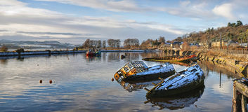 Bowling harbour panorama 01. A panoramic image of sunken fishing boats lined up in the scottish harbour at Bowling Royalty Free Stock Images