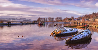 Bowling harbour panorama 02. A panoramic image of sunken fishing boats lined up in the scottish harbour at Bowling Stock Photography