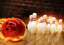 Bowling hit with fire ball rolling on the floor stock images