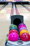 Bowling lane. Bowling balls in foreground with bowling lane in background stock photo
