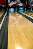 Bowling lane arrows. A bowling alley lane with narrow depth of field focusing in the middle on the arrows stock photography