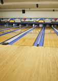 Bowling Lanes. Brightly Painted bowling alley featuring several lanes royalty free stock photos