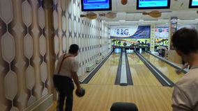 Bowling machine, bowling strike. Kiev, Ukraine, March 10 .2017: bowling club. People play bowling. Bowl rolls along the bowling track and strikes a strike stock video