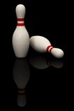 Bowling Pin. Two bowling pins isolated over a black background. This is a 3D rendered picture Royalty Free Stock Images
