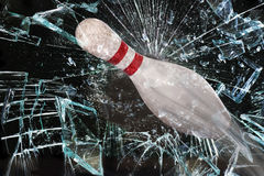 Bowling Pin Breaking Glass. Royalty Free Stock Images