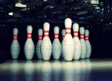 Bowling pins. Closeup view of bowling pins with artistic illumination royalty free stock photos