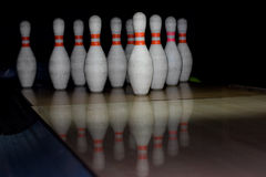 Bowling pins. On wood alley royalty free stock photos