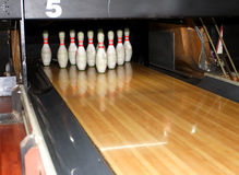 Bowling pins. Ten-pin bowling pins at a bowling alley.  Sometimes called skittles Stock Image