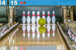 Bowling pins and ball. Bowling ball about to hit a bowling pins stock images
