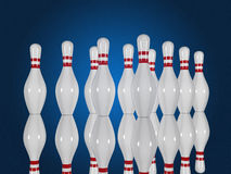 Bowling pins on a blue background Royalty Free Stock Photography