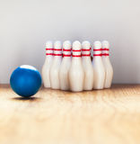 Bowling pins and bowling ball in miniature.  royalty free stock images