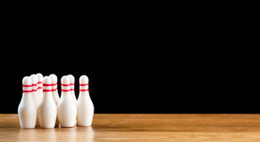 Bowling pins and bowling ball in miniature Stock Images