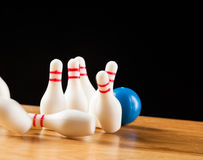 Bowling pins and bowling ball in miniature Stock Image
