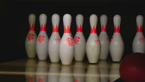 Bowling pins in the bowling club. NOVOSIBIRSK, RUSSIAN FEDERATION - FEBRUARY 27, 2016: Pins at the end of a bowling alley. Unsuccessful attempt. Family stock video footage