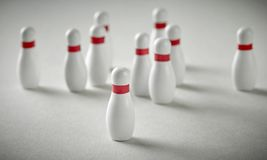 Bowling pins on grey background. Bowling pins on grey paper background royalty free stock photos