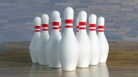 Bowling pins, white with red stripes aligned to get hit by a bowling ball