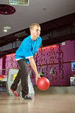 Bowling player. Photo of man bowling in a club stock photography