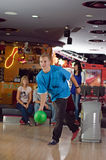 Bowling player. Photo of man bowling in a club stock images