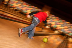 Bowling player. With colors ball in blur Stock Photos
