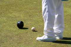 Bowling player and balls. On the playing ground Royalty Free Stock Image
