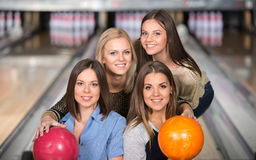 Bowling. Portrait of four happy women in bowling are looking at the camera stock photography