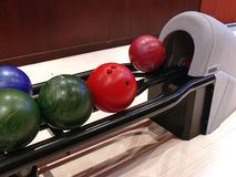 Bowling rack. A bowling rack detail, one bowl is just arriving Royalty Free Stock Images
