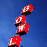 Bowling rink sign red blue sky. Bowling rink sign in portland oregon red with blue sky royalty free stock images