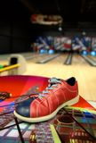 Bowling shoe. A bowling shoe on a table in alley stock photography
