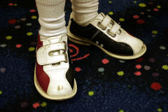 Bowling Shoes. A child wearing bowling shoes with clipping path Royalty Free Stock Photo