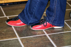 Bowling shoes. A pair of feet in bowling shoes Stock Image