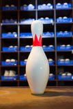 Bowling shoes and pins Stock Image
