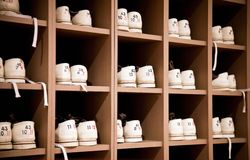 Bowling shoes on racks Stock Photos
