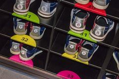 Bowling shoes in a shoe rack. In different sizes stock photography