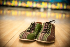 Bowling shoes. With stripes on the floor Stock Photo