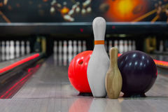 Bowling skittles and ball for bowling game. On the background of the playing field Royalty Free Stock Photos