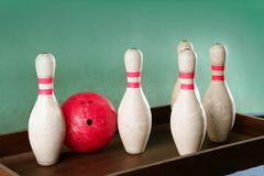 Bowling still life red ball over green background Royalty Free Stock Image