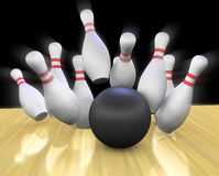 Bowling Strike. This is a 3d render of a bowling ball crashing into the pins Royalty Free Stock Photo