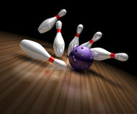 Bowling strike. A purple bowling ball crashes into ten bowling pins sending them flying in a 3d bowling ally Royalty Free Stock Image