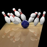 Bowling a strike on black background. Bowling a strike in action with all pins in the air on black background Stock Photo
