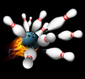 Bowling Strike Concept. A flaming bowling ball smashing into pins getting a strike Royalty Free Stock Images