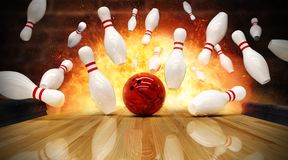 Bowling strike hit with fire explosion royalty free stock photography