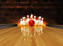 Bowling strike hit with fire explosion royalty free stock images